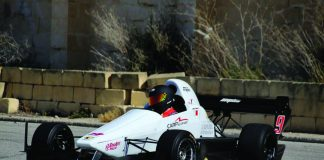 Zach Zammit and his Empire racing car.
