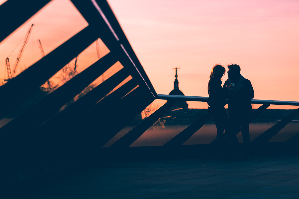 boyfriend + girlfriend in front of a sunset