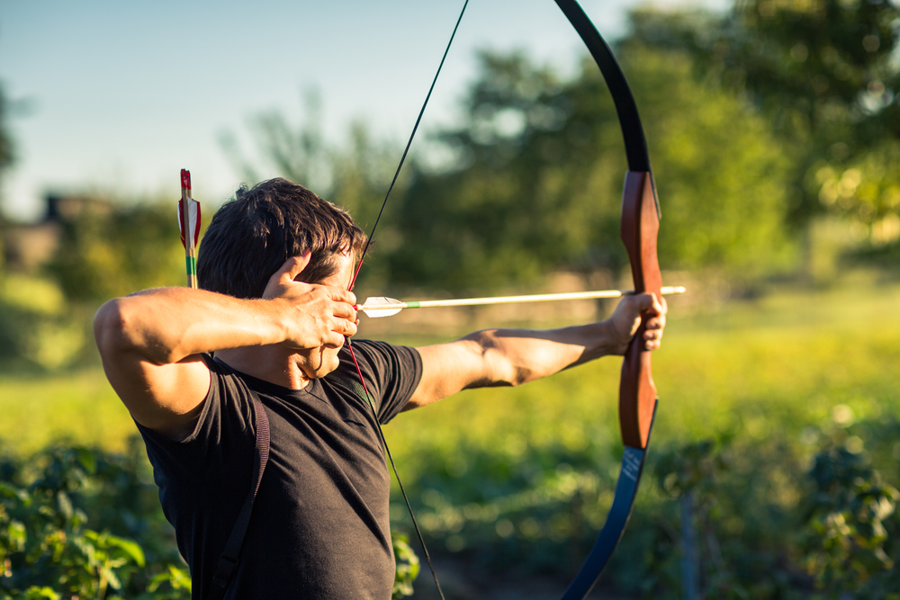 a man practising archery